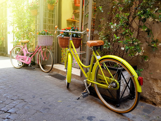 Colorful bicycles parked on the old narrow street in Rome, Italy
