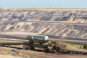 Brown coal open pit landscape with conveyer belt in Garzweiler mine Germany
