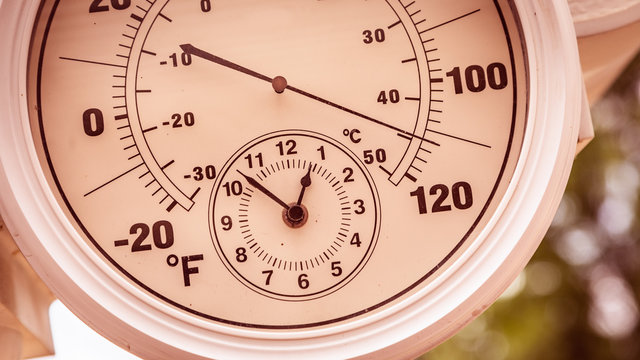 Round Thermometer Showing Over 110 Degrees