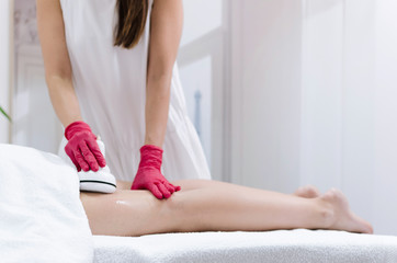Radiofrequency lifting massage of legs