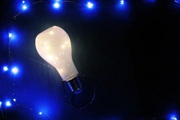 Glowing lightbulb on black background, idea concept
