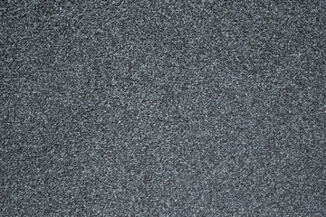 A wall covered with a stone crumb in gray color