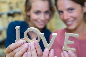 women holding love letters