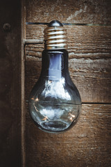 light bulb in front of a wooden wall