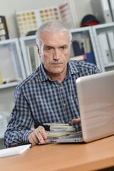 Senior office worker at his desk
