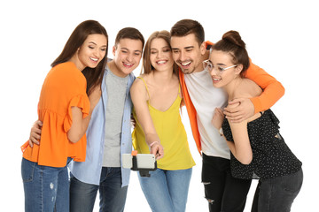 Young happy friends taking selfie against white background
