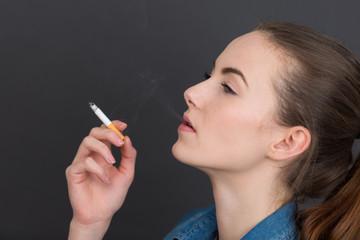 woman smoking slim cigarette