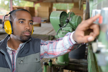 worker adjusting the machine