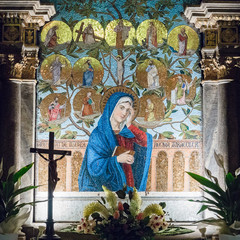Altar dedicated to the Virgin Mary depicted in a colorful mosaic.