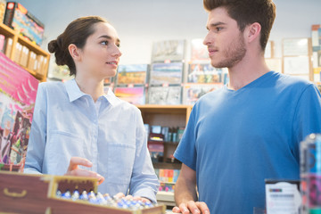 male and female teen in party games store