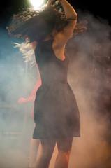 portrait of attractive girl dancing in night club