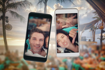 composite of young beautiful and happy mixed ethnicity Asian and Caucasian couple and mobile phones in love and posting selfie picture on internet