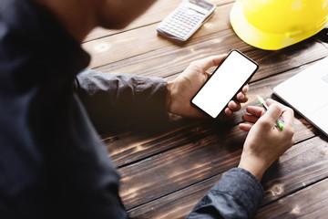 engineering using phone mobile on desk