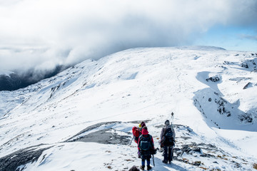 People hiking on the beautiful snow mountains. kahurangi national park, New Zealand.
