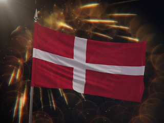 Flag of Denmark with fireworks display in the background