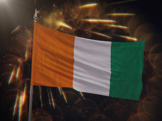 Flag of Cote d Ivoire with fireworks display in the background