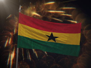 Flag of Ghana with fireworks display in the background