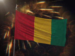 Flag of Guinea with fireworks display in the background