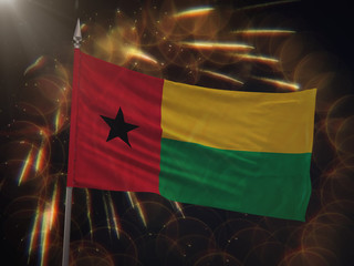Flag of Guinea-Bissau with fireworks display in the background