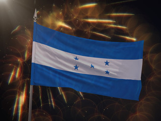 Flag of Honduras with fireworks display in the background