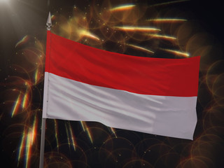 Flag of Indonesia with fireworks display in the background