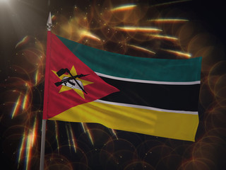 Flag of Mozambique with fireworks display in the background