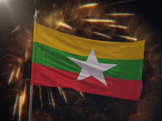Flag of Myanmar with fireworks display in the background