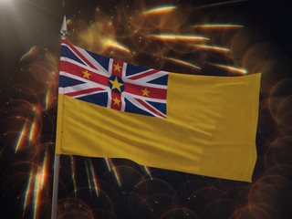 Flag of Niue with fireworks display in the background