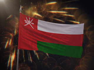 Flag of Oman with fireworks display in the background