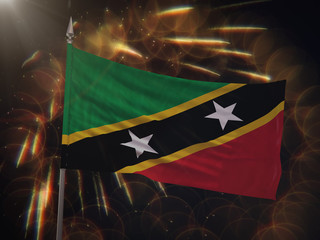 Flag of Saint Kitts and Nevis with fireworks display in the background