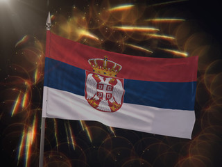 Flag of Serbia with fireworks display in the background