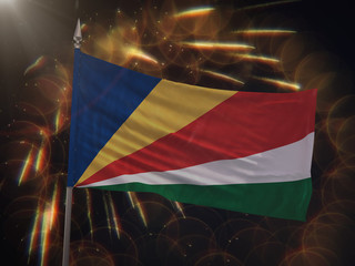 Flag of Seychelles with fireworks display in the background