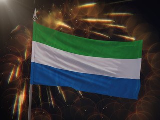 Flag of Sierra Leone with fireworks display in the background