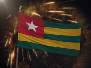 Flag of Togo with fireworks display in the background