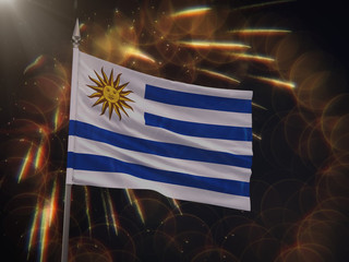 Flag of Uruguay with fireworks display in the background