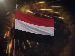 Flag of Yemen with fireworks display in the background