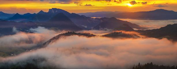 Fototapeta spectacular, fairytale sunset over the mountains, floating mist highlighted by the setting sun, Pieniny, Slovakia obraz