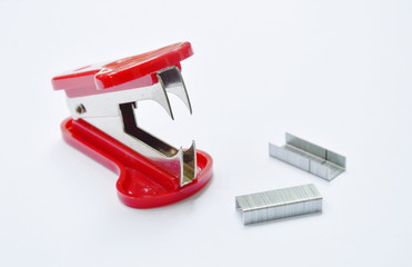 red staple remover and refill on white table