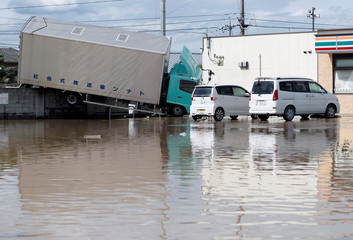 A truck which was stranded by flood is seen in a flooded area in Mabi town in Kurashiki