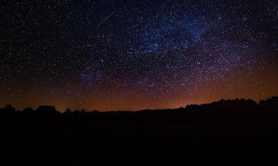 Milky way galaxy and sunset on horizon