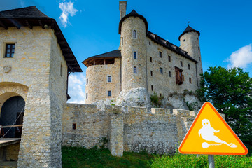 Bobolice, Poland - August 13, 2017: a sign of the ghost in the background of the castle of Bobolice