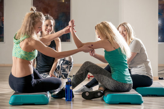 women friends communicate in the gym after a tiring workout