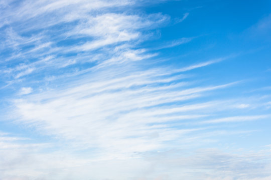 High cirrus clouds with blue sky background.