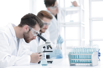 background image scientists working with the microscope