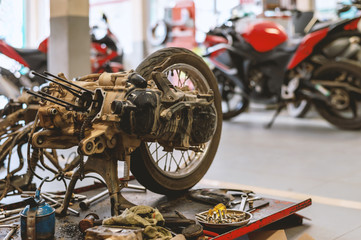 motorcycle in repair station with soft-focus and over light in the background