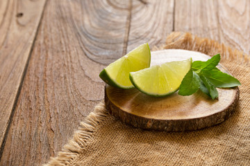 Fresh lime on the brown wooden table