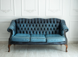 Beautiful antique blue sofa on a light background