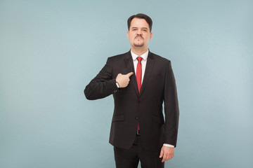 Printed kitchen splashbacks Artist KB Man in classic wear pointing himself at camera. I did it and I'm proud of it. indoor studio shot. isolated on light blue background. handsome businessman with black suit, red tie and mustache.