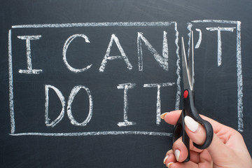 using scissors to remove the word can't to read I can do it concept for self belief, positive attitude and motivation