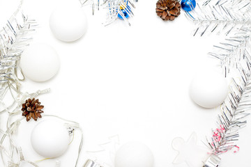 Christmas frame made of silver fir branches, white balls, pine cones - holidays, winter and celebration concept